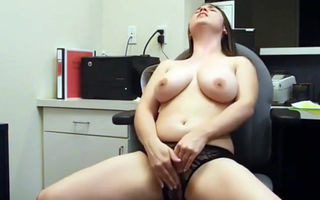 brings herself to orgasm at work..